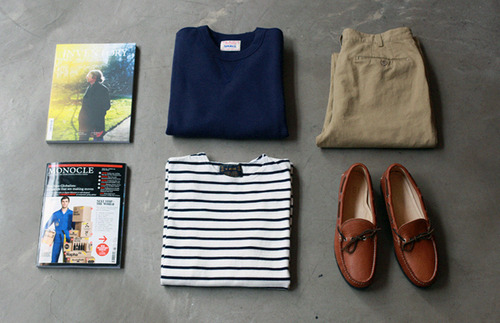 Monocle magazine, leather deck shoes, blue striped sailor top, chinos and a sweater