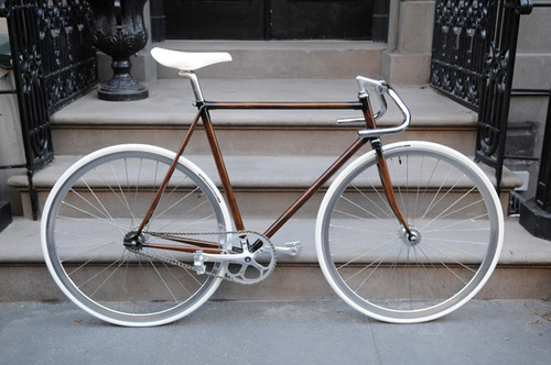 Single-Speed bike with white tires and dropped handle bars