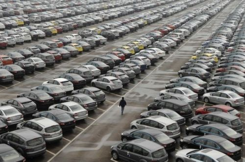Rows of cars in Houston, via Houston Free Press